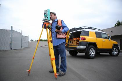 Worker surveying a property